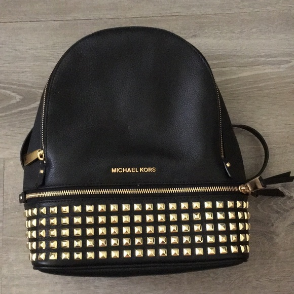 3f4fa2fb3356 Michael Kors Rhea Medium Studded Leather Backpack.  M_5b81dc1f1b16db45f7c547d8